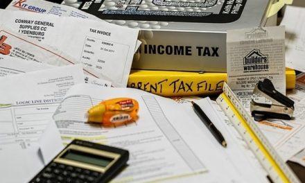 Link PAN card and Aadhaar via income tax portal or SMS